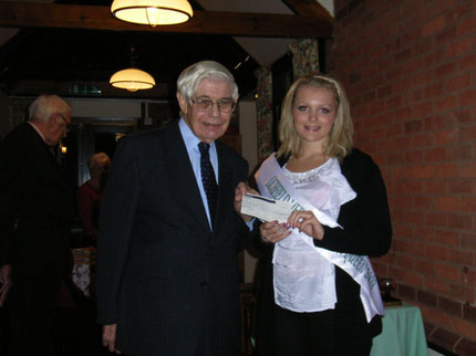 Image of Bower Queen presenting cheque to Chairman