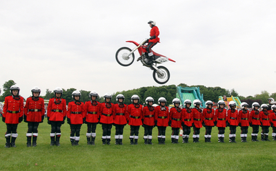 Image of stunt bike jumping over people