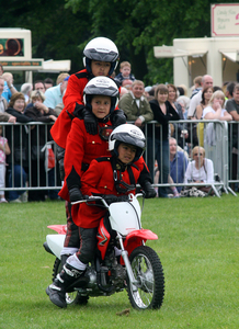 Image of 3 kids on a bike