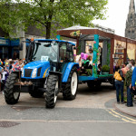 Image of tractor towing Erasmus Darwin Float