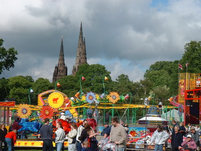 Image of Fun Fair with Cathedral in background