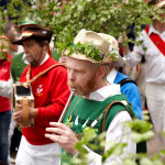 Image of Green Man's Morris and Sword Club playing musical instruments